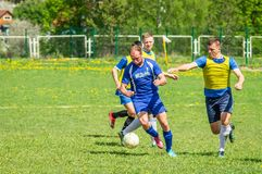 Amateur football match in Kaluga region of Russia. The Kaluga region annually hosts the football championship, in which teams from different cities of the stock photo