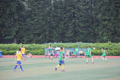 Amateur football match in SHENZHEN. Although is a amateur football match, but exercise enthusiasts bodies and team work spirit stock image
