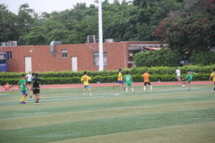 Amateur football match in SHENZHEN. Although is a amateur football match, but exercise enthusiasts bodies and team work spirit royalty free stock photo