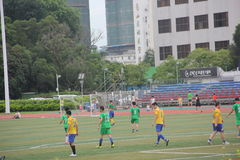 Amateur football team in SHENZHEN. Although is a amateur football match, but exercise every team bodies and team work spirit stock photo