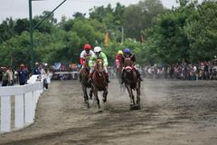 Amateur Horse Race. Jockeys race during an amateur horse racing event, at Wonogiri, Central Java, Indonesia Stock Photography