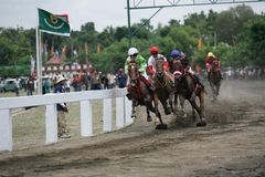 Amateur Horse Race. Jockeys race during an amateur horse racing event, at Wonogiri, Central Java, Indonesia Stock Image