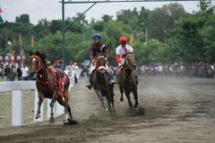 Amateur Horse Race. Jockeys race during an amateur horse racing event, at Wonogiri, Central Java, Indonesia Royalty Free Stock Photos