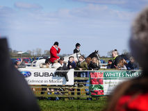 Amateur Horse Racing Jumping over Fences. Huntsman walking the course at Oakley Point to Point. Amateur horse racing over jumps stock images
