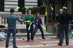 Amateur jugglers train in Bryant Park during lunch break. New York, USA - May 1, 2018: Amateur jugglers train in Bryant Park during lunch break royalty free stock photography