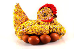 Amateur knitted hen on eggs. Isolated on the white background stock images