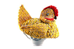 Amateur knitted hen on a tea brewing teapot. Isolated on the white background stock photography