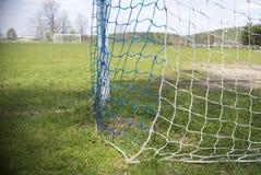 Amateur Net soccer goal football. Green grass stock photos
