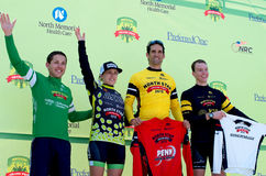 Amateur Omnium Winners Podium at Stillwater. Stillwater, Minnesota, USA – June 21, 2015: Winners of Amateur Omnium race categories wave to crowd from royalty free stock image