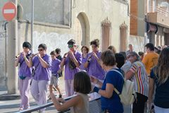 Malgrat de Mar, Spain, August 2018. Amateur orchestra of the district marches ahead of the figures of fairy-tale heroes. stock photos