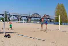 Amateur pairs play beach volleyball on a Dnipro river central beach in the same name city. DNIPRO, UKRAINE - APRIL 29, 2018: Amateur pairs play beach volleyball royalty free stock photo