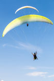 Amateur paragliders in blue sky with clouds Royalty Free Stock Photos