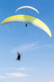 Amateur paragliders in blue sky with clouds Royalty Free Stock Images