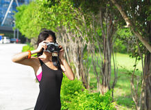 Amateur photographer. Asian young girl amateur photographer stock image
