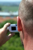 Amateur Photographer. Man taking a digital picture, use display view in his compact camera Royalty Free Stock Images