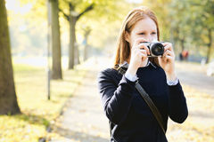 Amateur Photographer in a City Park Stock Images