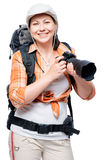 Amateur photographer with a good camera and a large backpack. On a white background royalty free stock images
