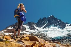 Hiker. Amateur photographer and hiker takes picture of the mountain with glacier. Cerro Castillo Mountain, Chile stock image