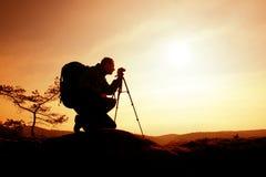 Amateur photographer takes photos with mirror camera on neck.  Dreamy foggy landscape Stock Photos