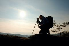 Amateur photographer takes photos with mirror camera on neck.  Dreamy foggy landscape Stock Images