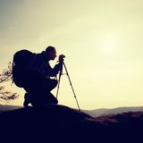 Amateur photographer takes photos with mirror camera on neck.  Dreamy foggy landscape Royalty Free Stock Photo
