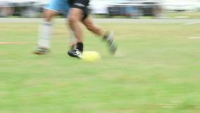 Amateur player falls down on ground trying to get the ball. Stock footage stock footage