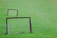 Amateur playing field - Green meadow with two goals stock photography