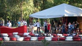 Amateur racing karting, leisure park visitors stock footage
