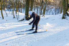 Amateur skier moves down the hill. GRODNO, BELARUS - JAN 06: Amateur skier moves down the hill in a snowy forest at January 06, 2017 in Grodno, Belarus royalty free stock photos