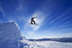 Amateur snowboarder. Amateur snowboarder making a grab in big air jump Royalty Free Stock Images