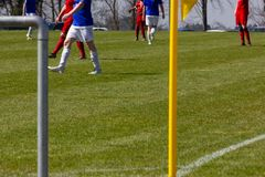 Amateur soccer field. With green lawn and white lines with yellow pole on the corner edge stock image