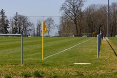 Amateur soccer field. With green lawn and white lines with yellow pole on the corner edge stock photo