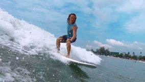 Amateur surfer rides the wave stock footage
