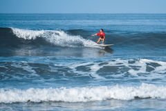 Amateur surfer rides the wave Stock Images