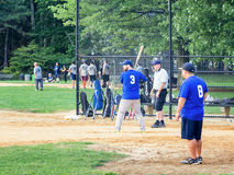 Amateur team playing baseball at Central Park in New York. NEW YORK,USA- AUGUST 19,2015 : Amateur team playing baseball at Central Park in Manhattan royalty free stock photo