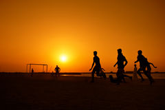 Amateurs playing football at Jumeira beach in Dubai Royalty Free Stock Photo