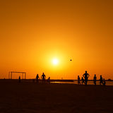 Amateurs playing football at Jumeira beach in Dubai Royalty Free Stock Photos