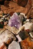 Amatista en rocas Fotos de archivo
