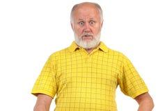 Amazed and astonished senior bald man. In yellow shirt Royalty Free Stock Photos