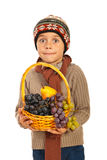 Amazed autumn boy with grapes. Amazed autumn boy holding basket with grapes and pears isolated on white background Stock Photo