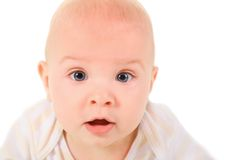 Amazed baby is creeping on all fours, looking. Royalty Free Stock Photo