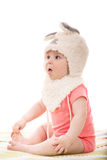 Amazed baby girl  with bunny ears Royalty Free Stock Photo