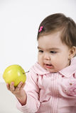 Amazed baby of a green apple Royalty Free Stock Image