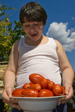 Amazed baby with tomatoes Stock Photo