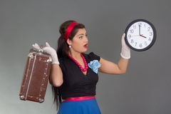 Amazed beautiful pinup woman with suitcase and clock Stock Image