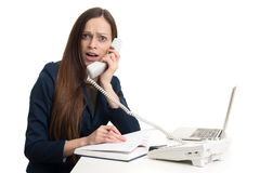 Amazed beautiful woman talking on telephone Stock Image
