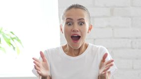 Amazed Beautiful Young Woman by Surprise, Portrait Stock Photo