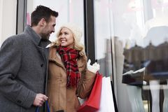 Christmas shopping. Amazed by big sales in the stores Stock Photos