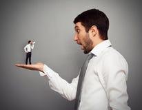 Amazed boss with small man Stock Photo