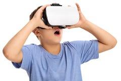 Amazed boy experiencing virtual reality. Isolated on white background Stock Photo